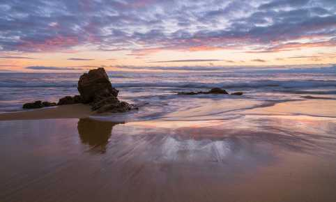 Corona del Mar, California beach with rocks and colorful clouds at sunset by Desi Drew Photography landscape