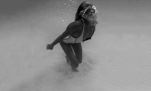 Cait Miers underwater black and white photography Abysse Elle one piece swimsuit