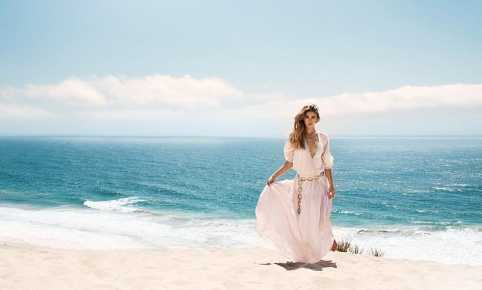 Aaron Woolf Haxton photography Carmella Rose in front of blue ocean in Malibu Sand Dunes wearing Indah Clothing